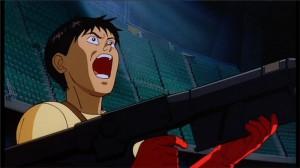 Kaneda choqué par la mutation de Tetsuo après que ce dernier ait perdu le contrôle de son pouvoir