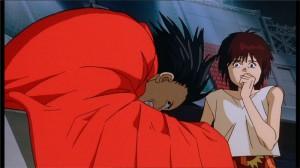 Kaori voit Tetsuo malade au stade avec un bras métallique