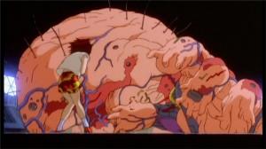 Après être partie le chercher, Kaori voit Tetsuo perdre tout contrôle sur sa forme humaine