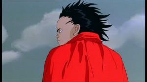Tetsuo pensif alors qu'il va vers le stade où est caché Akira
