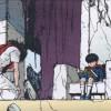 Tetsuo s'agenouille devant Akira suite à l'explosion de Neo-Tokyo.