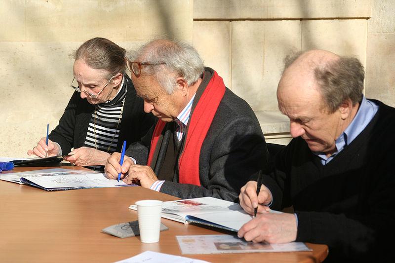 séance de dédicaces au Festival BD des Grandes Écoles à l'École Normale de Paris le 28 février 2009. de droite à gauche : Jean-Claude Mézières (dessinateur), Pierre Christin (scénariste), Éveline Tranlé (coloriste) [source : Hamelin de Guettelet]