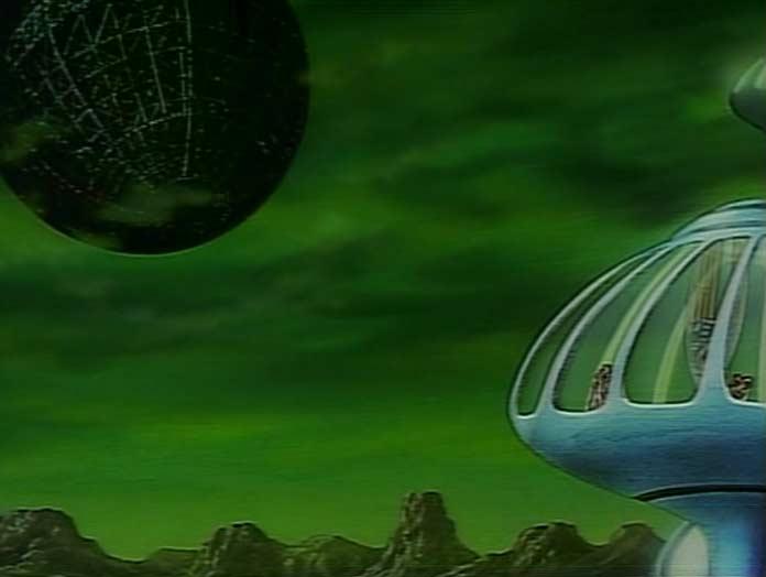 à coté du palais de Wotan, l'énorme planète de métal est une forteresse mobile