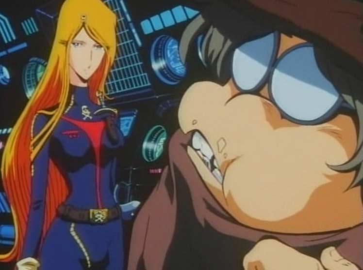 Emeraldas joue la serveuse apportant à boir et à manger à Toshirô pendant qu'il travaille (Flash back dans Queen Emeraldas - 2002)