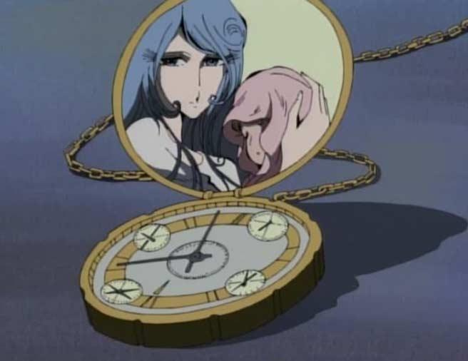 Hell Maetel montre à Marina le médaillon de Warius qui contien la photo de sa femme et son bébé tués par les humanoïdes