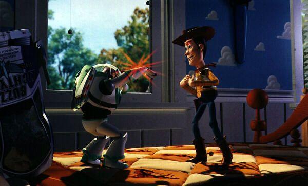 Buzz tente d'impressionner Woody avec son lazer