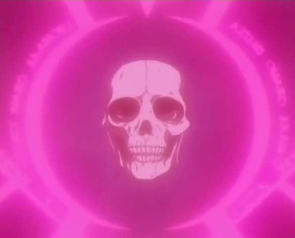 Au centre du sceau se trouve le crâne de l'humain qui a donné naissance à Greed